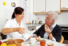 caregiver preparing meals to her patient