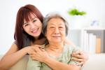 young woman hugging senior